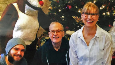 Nathan Lambrecht (left), his father, Doug (centre), and his mother, Karen, in December 2019, two months before Doug Lambrecht died from COVID-19.