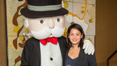 Maryam Awang alongside Mr Monopoly.