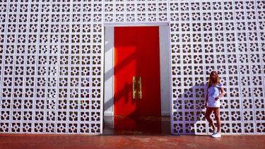 Catherine Chisholmat entrance of Parker Palm Springs hotel.