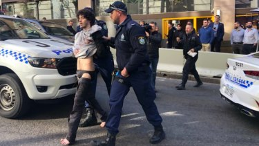 Mert Ney is arrested after being detained by members of public.