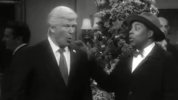 Baldwin as Trump, with Kenan Thompson, in the SNL skit.