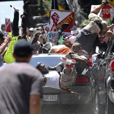 People fly into the air as a vehicle drives into a group of protesters demonstrating against a white nationalist rally in Charlottesville, Virginia.