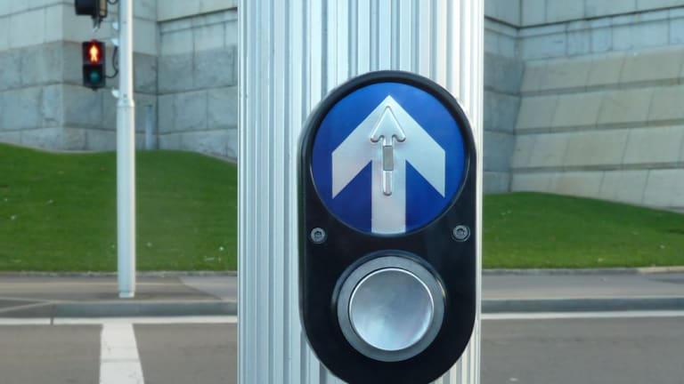 Pedestrian traffic light buttons are deactivated in the city most of the time.