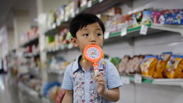 A boy stands in the aisle at the Potonggang department store in Pyongyang, North Korea. Three generations into Kim Jong-un's ruling dynasty, a consumer culture is taking root.