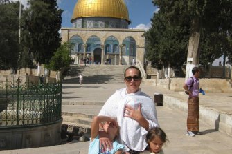 Rachel Lord with two of her daughters in Jerusalem during their time living in Israel, where her husband - now the Liberal MP Dave Sharma - was the Australian ambassador.