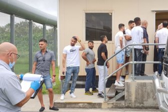 Advocates say 23 of the men were taken by bus to the Brisbane Immigration Transit Accommodation site to have their releases processed - along with two others already at the detention centre.