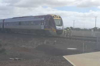 Emergency services inspect a train that was involved in the collision near Rockbank on Monday morning.