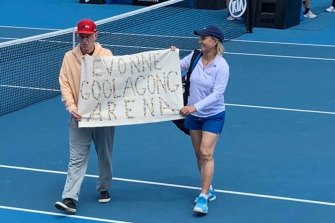 John McEnroe and Martina Navratilova with a banner to protest for the renaming of Margaret Court Arena.