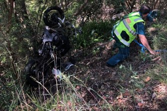 A man is rescued by emergency services after he was thrown down an embankment following the accident.