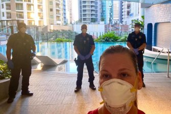 Ali Kirkpatrick is guarded by police as she runs on the pool deck level of a hotel.