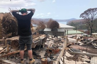 Anthony Brennan returns to the ruins of his Conjola home.