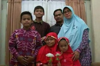 Dita Oeprianto and his wife Puji Kuswati with their four children. All six family members were involved and died in the suicide attacks.