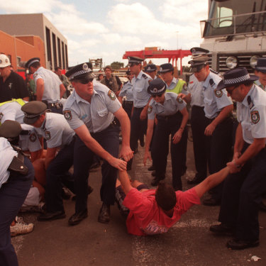 Police move protesters off the picket line at Patrick.