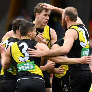 The Tigers celebrate a Tom Lynch goal against his former club.