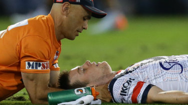 Down and out: Luke Keary receives attention before leaving the field.
