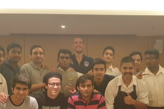 Erik Paartalu (rear) with the players and staff from Bengaluru in hotel quarantine
