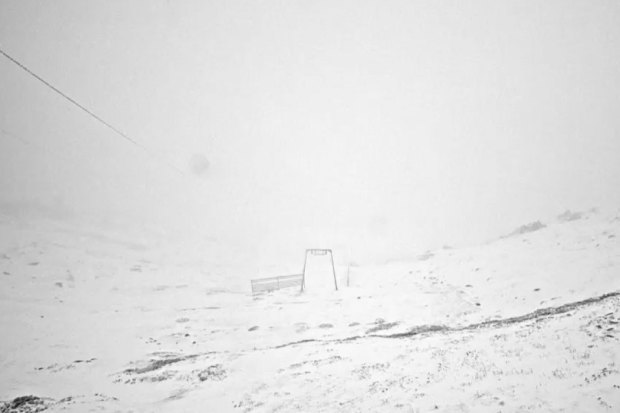 Snow has fallen at popular ski resorts as a cold front pushes across the state.