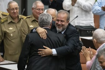 Cuban Prime Minister Manuel Marrero Cruz embraces Cuba's President Miguel Diaz-Canel at the National Assembly of Popular Power in Havana, Cuba.