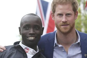 Prince Harry poses with London Marathon winner Daniel Wanjiru.