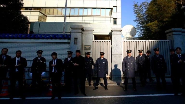 Japanese police guard the headquarters of the pro-Pyongyang General Association of the Korean Residents in Japan in Tokyo during protests against North Korea.