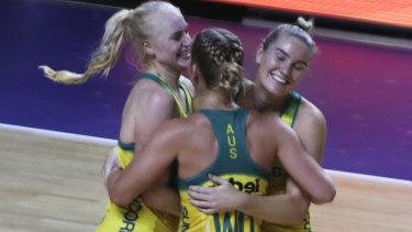 Australia's players congratulate each other after winning their Netball World Cup semifinal