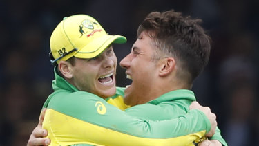 Marcus Stoinis and Steve Smith celebrate a wicket.