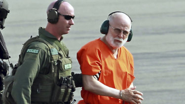 Bulger is escorted from a helicopter in 2011 after a court hearing.