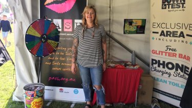 Binx Thompson, a sexual health worker, in the Down to Test tent at Splendour in the Grass.