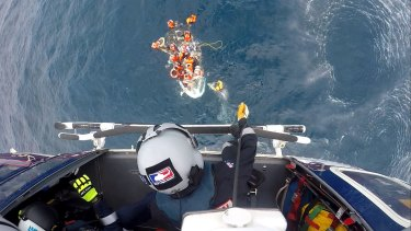 The RACQ Capricorn Rescue helicopter winched one person to safety from the sinking dinghy.