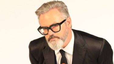 Comedian Paul McDermott's glasses are a defining feature of his appearance.