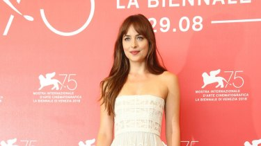 Actor Dakota Johnson poses for photographers at the photo call for the film Suspiria at the 75th edition of the Venice Film Festival in 2018.