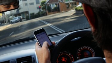 Road safety experts have been shocked by the lengths motorists go to hide mobile use.
