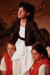 Actors disembark a boat on the Yarra River and arrive on stage at Fairfield Park in 1984 for <i>Iphigenia in Aulis.
