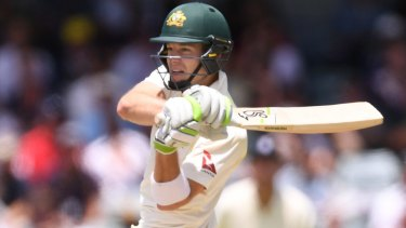 Under the pump: Captain Tim Paine fell cheaply as Pakistan ran through Australia's middle and lower order.