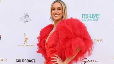 Leila McKinnon in a fire-engine red gown arrives at the 2019 Logie Awards at The Star Gold Coast.