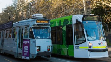 Old and new: Two models of trams in Melbourne.