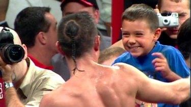 Tim Tszyu and dad Kostya celebrate victory over Jesse James Leija in 2003.