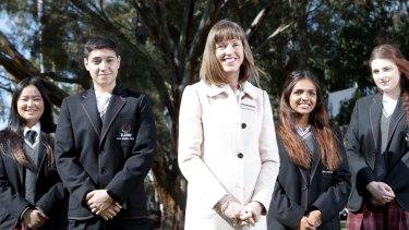 St Albans Secondary College principal Kerrie Dowsley with students Francisco Passadore-Rocha, Christie Vo, Brigitte Thomas and Nikolina Arnaut at the school in 2014.