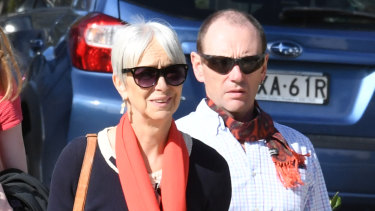 Caitlyn Fischer's parents Ailsa Carr and Mark Fischer arrive at Lidcombe Coroner's Court.