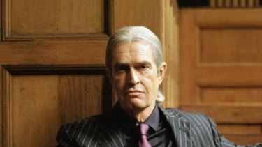 Rupert Everett as an ageing and seedy porn impresario in Adult Material.
