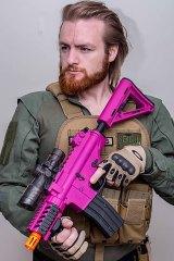 Brad Towner with an 'M4 Pink Commando' gel gun blaster. Picture supplied.