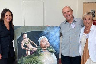 Senator Jacqui Lambie in her office with the Bald Archy portrait depicting her as Princess Leia and Clive Palmer as Jabba the Hutt, which was dropped off by owners Ray and Elain.