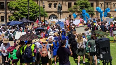 Students descend on Queensland Parliament, rallying for action on climate change.