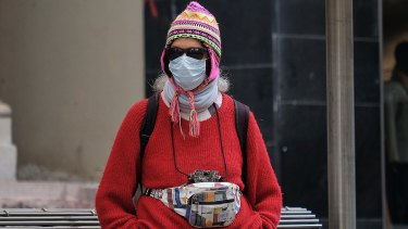People wear masks in the city.