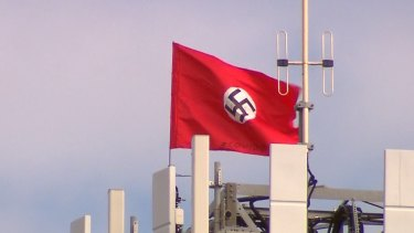 A large swastika has been planted on the top of a phone tower at Kyabram. There are also two Chinese flags.