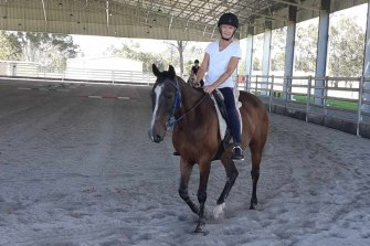 Cathy on her horse who, like many pets, is getting some extra care and attention.