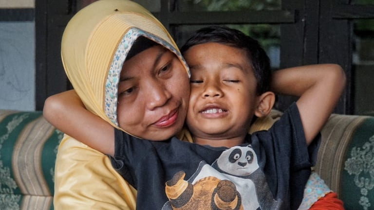 Baiq Nuril Maknun and her youngest son, seven-year-old Rafi.