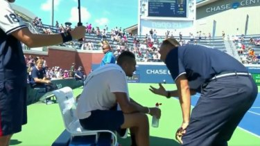 An umpire has come under fire for giving Nick Kyrgios a pep talk at the US Open. Kyrgios went on to win the match.