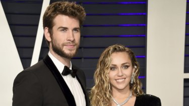 Liam Hemsworth and Miley Cyrus at the Vanity Fair Oscar Party.