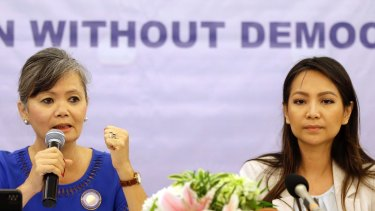 Vice President of the Cambodia National Rescue Party (CNRP), Mu Sochua, left, speaks at a press conference with Monovithya Kem, CNRP Deputy Director for Foreign Affairs, in Jakarta, Indonesia. Monday, July 30, 2018. The two exiled opposition politicians condemned Cambodia's election on Sunday as a sham. (AP Photo/Tatan Syuflana)